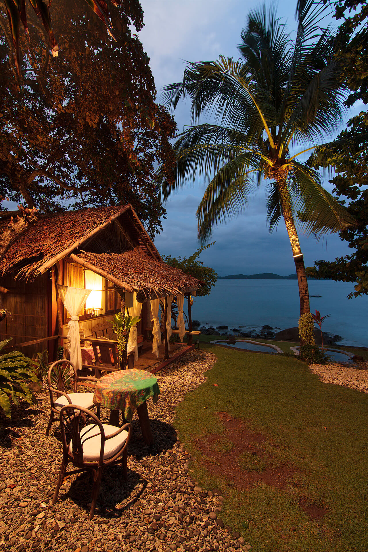 A villa in Lilom Resort overlooking the beach at dusk