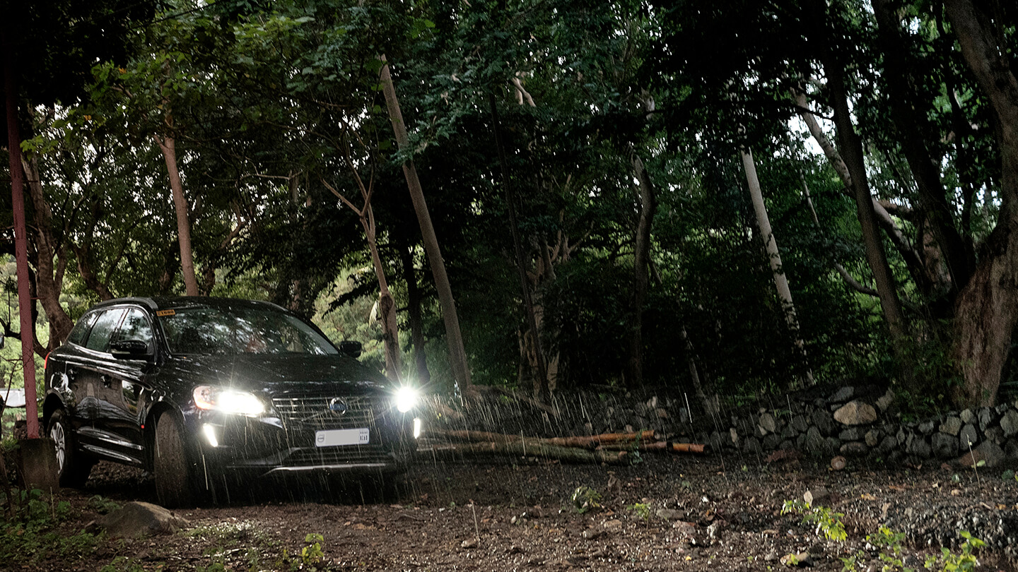 The Volvo XC60 driving along a dirt road