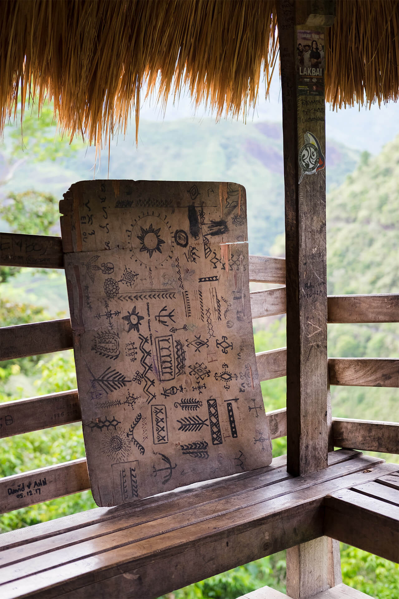 A wood board with sample tattoo designs