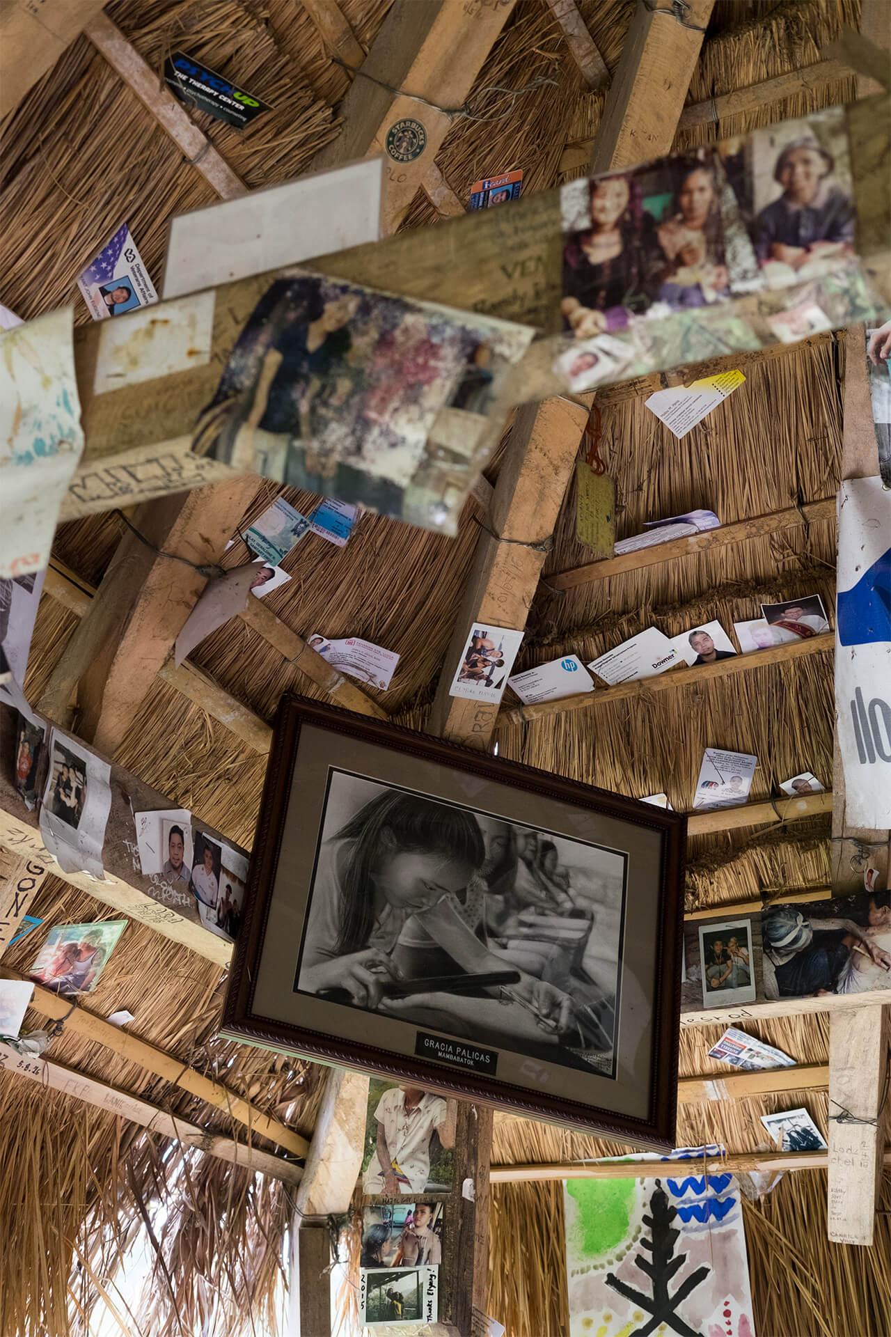 Photos of customers displayed around their hut