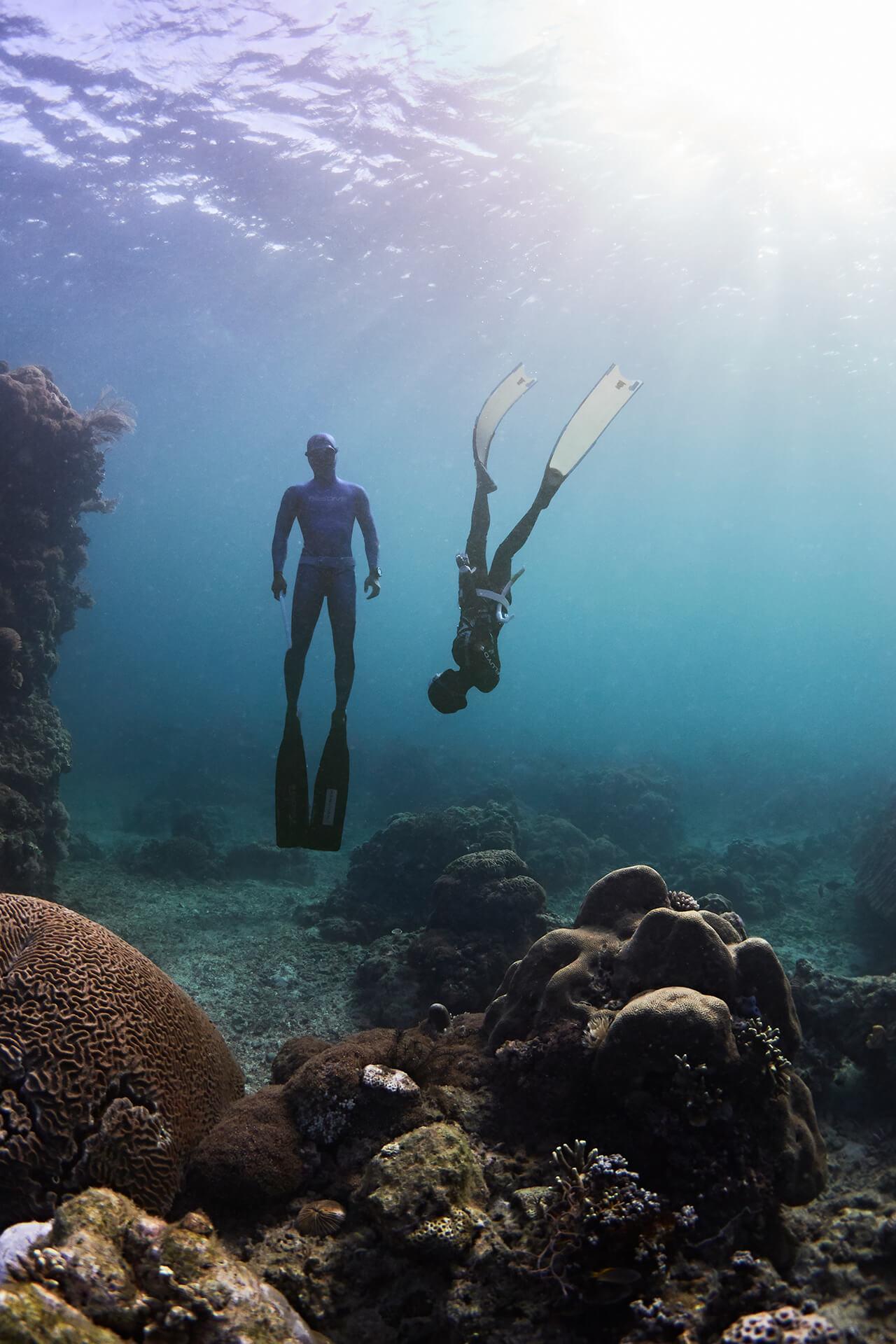 Two freedivers underwater