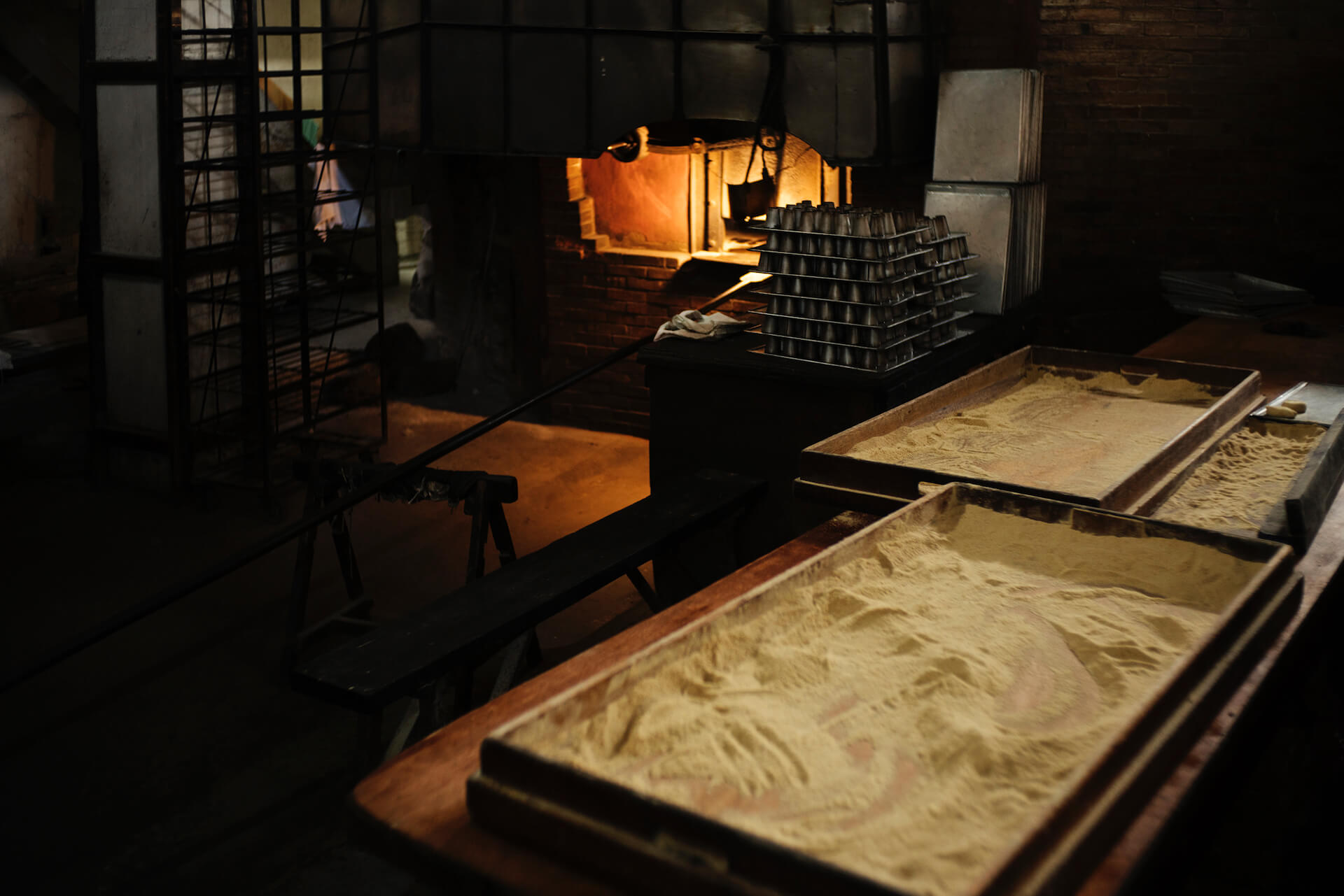 The bakers' work stations near a wood-fired oven at Panaderia Dimas-Alang