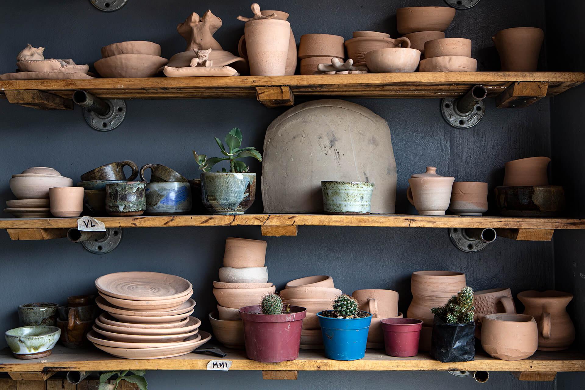 three shelves with various ceramic wares at Tahanan Pottery
