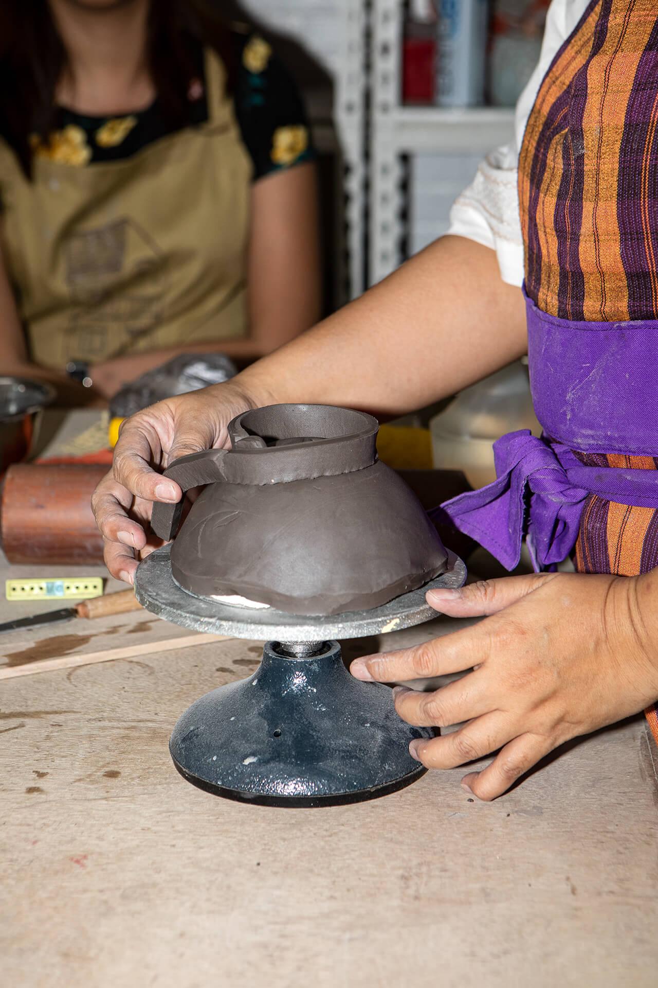 Rita Gudiño creates a bowl in a demonstration at Tahanan Pottery