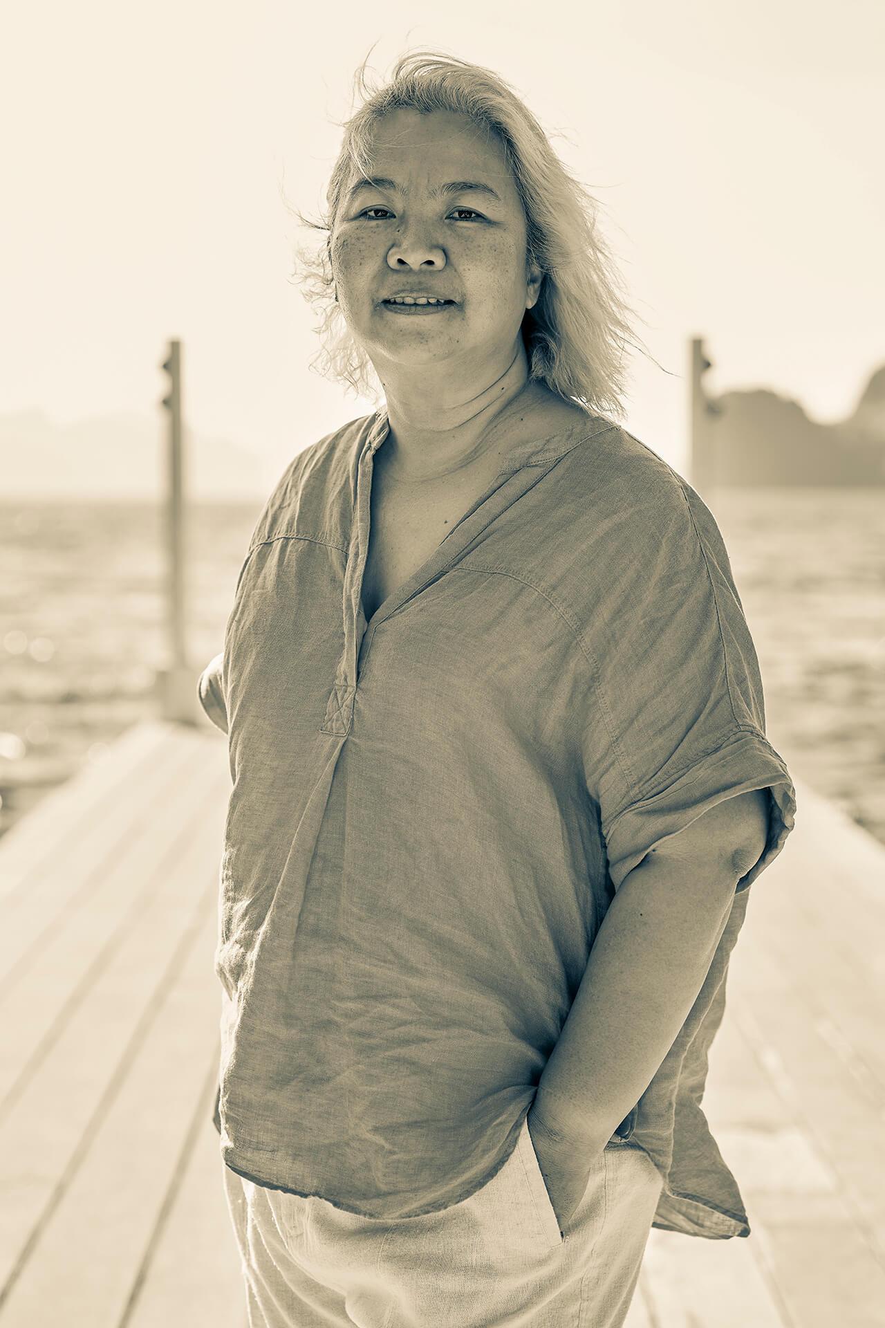 Marigs Laririt poses on a deck.