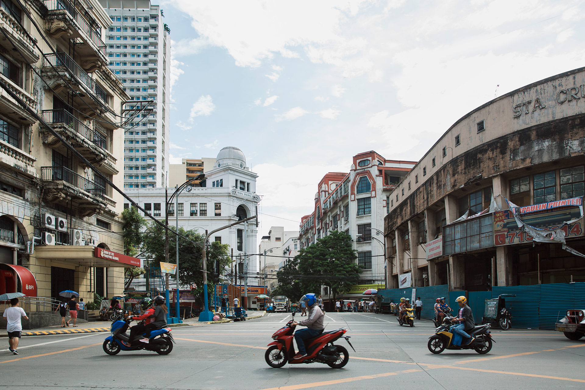 Motorcyles driving along the streets of Old Manila