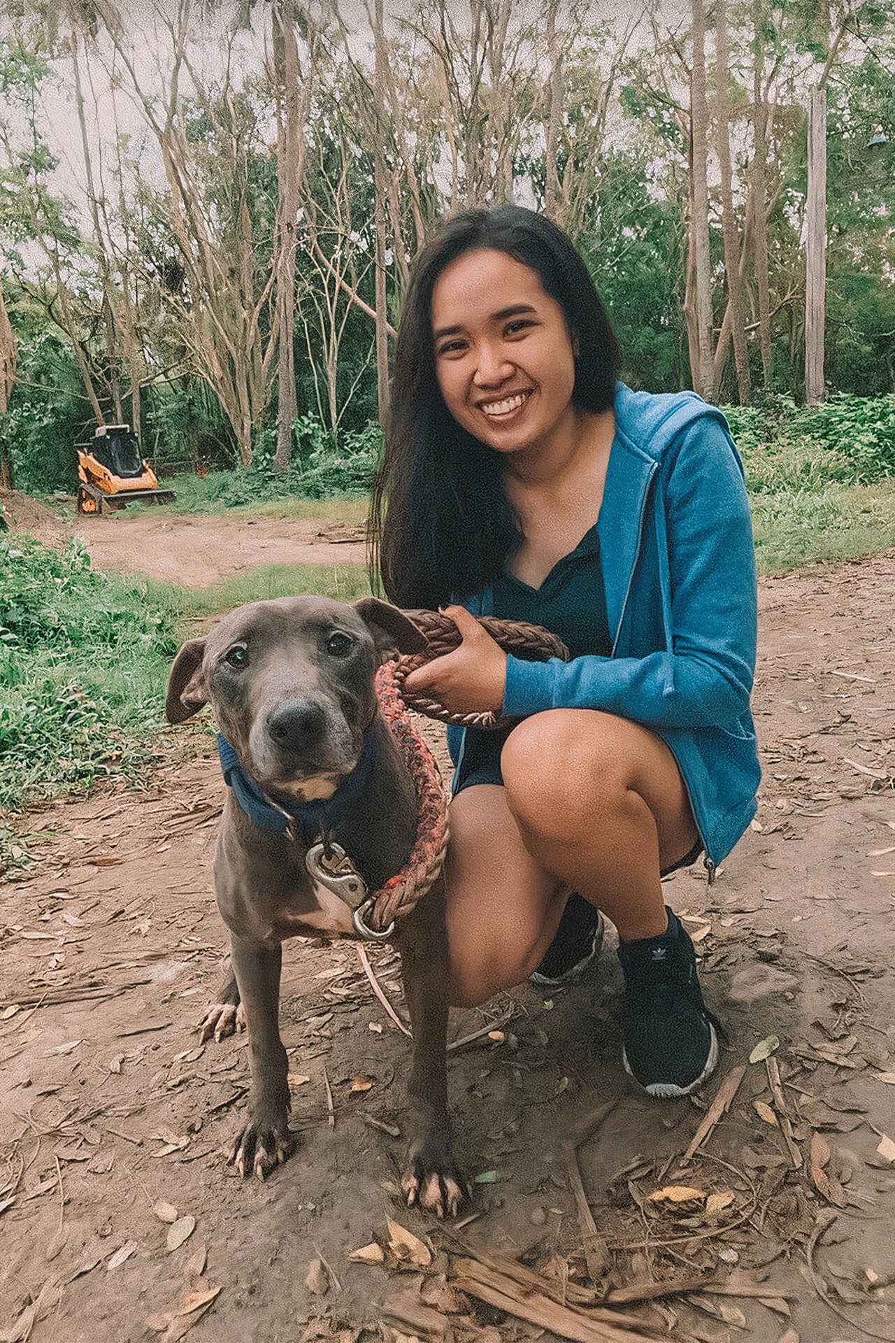 A volunteer with Baron, a pitbull rescue.