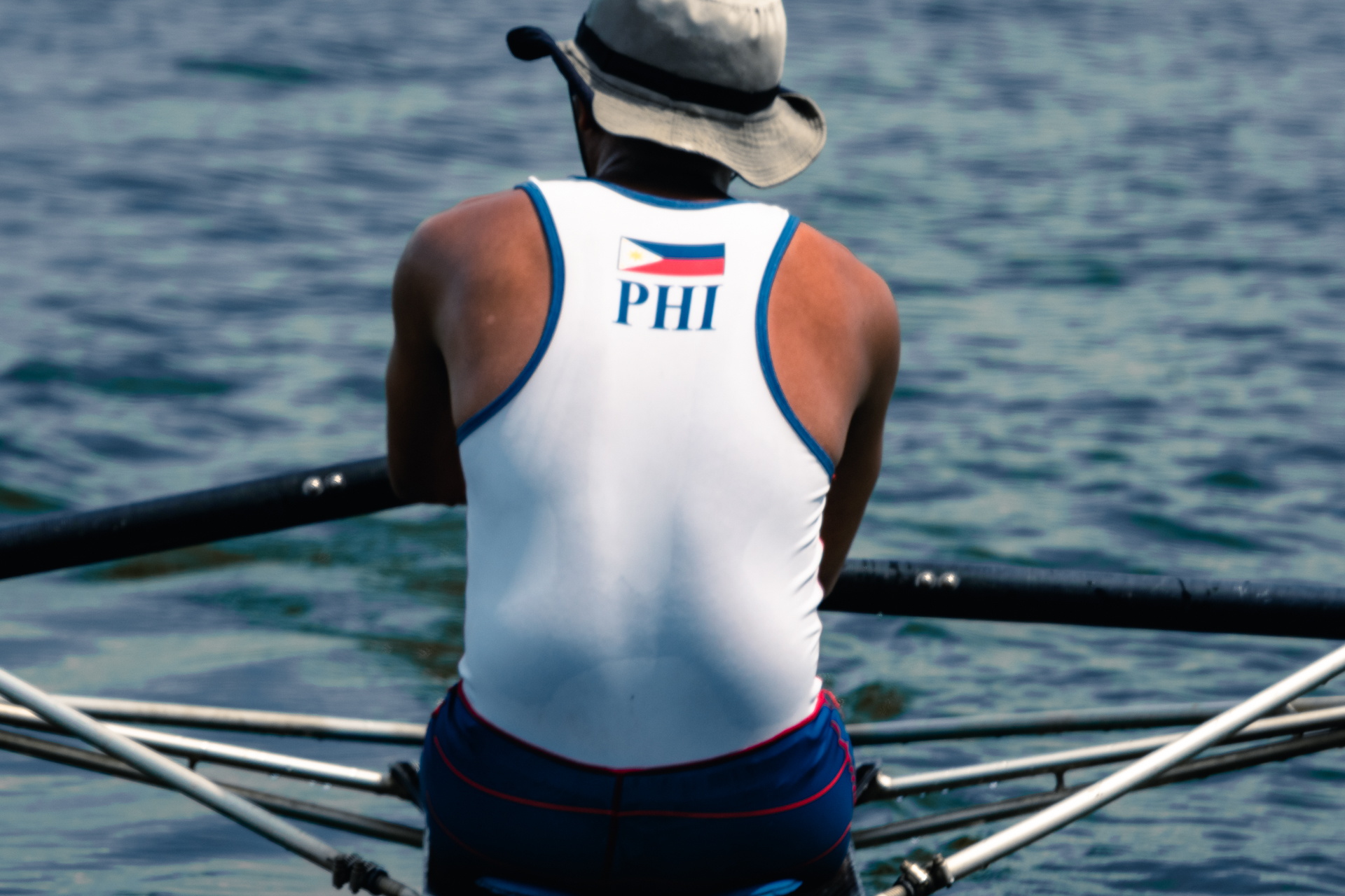 A member of the Philippine National Rowing Team faces the water at La Mesa Dam