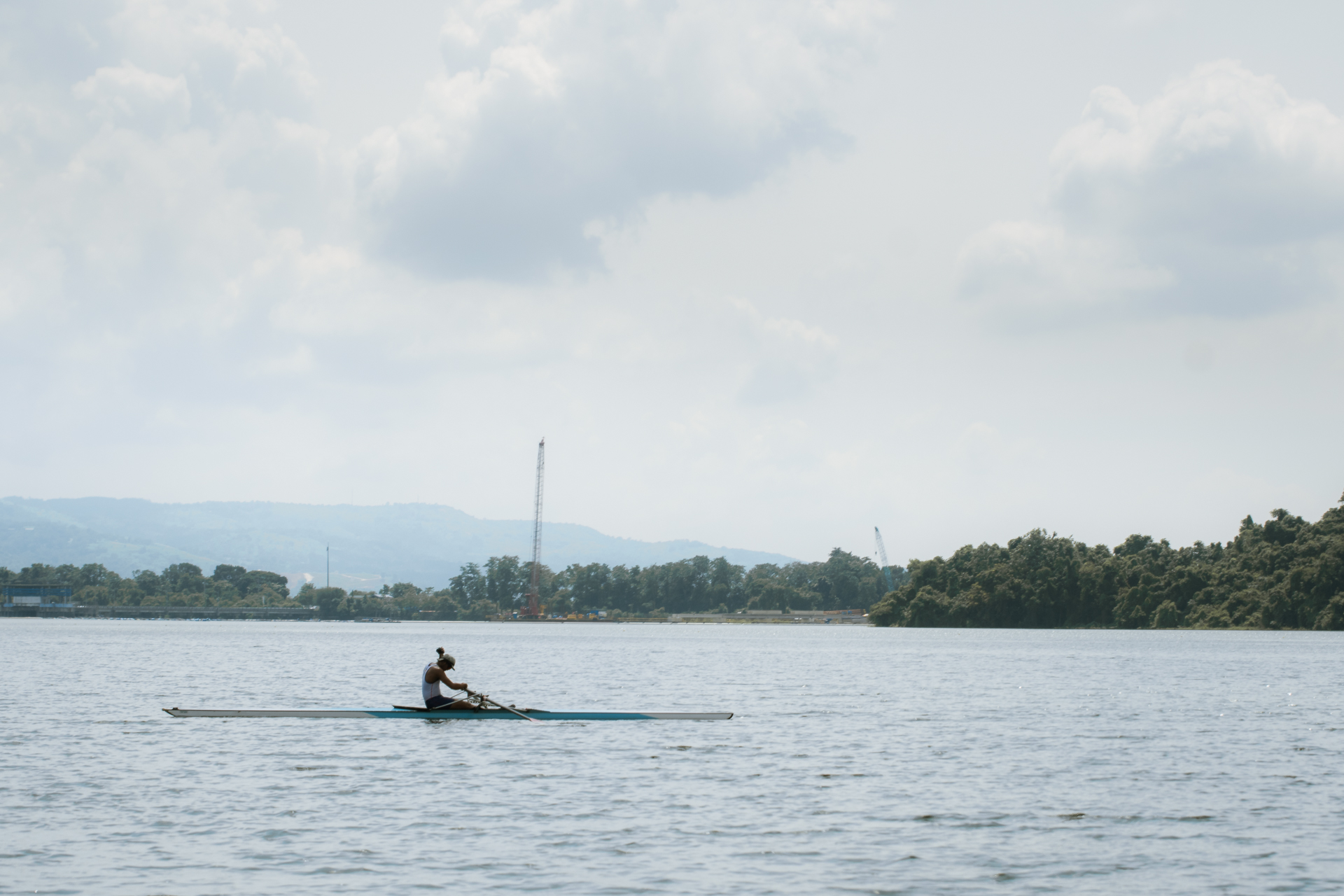 A female athlete rows in La Mesa Dam