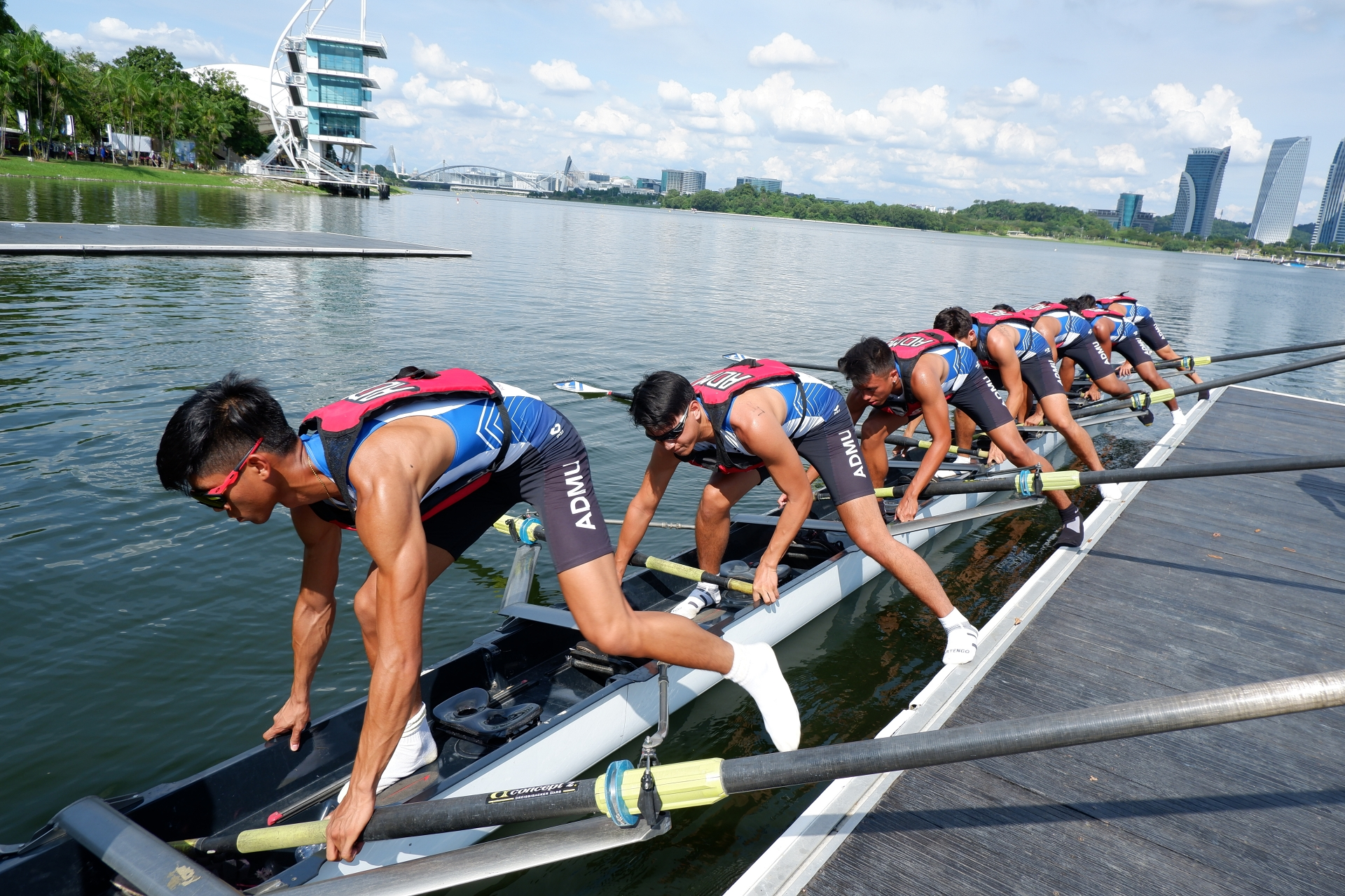 Members of the Ateneo Men's Rowing Team enter their boat at the Varsity Boat Race in Malaysia