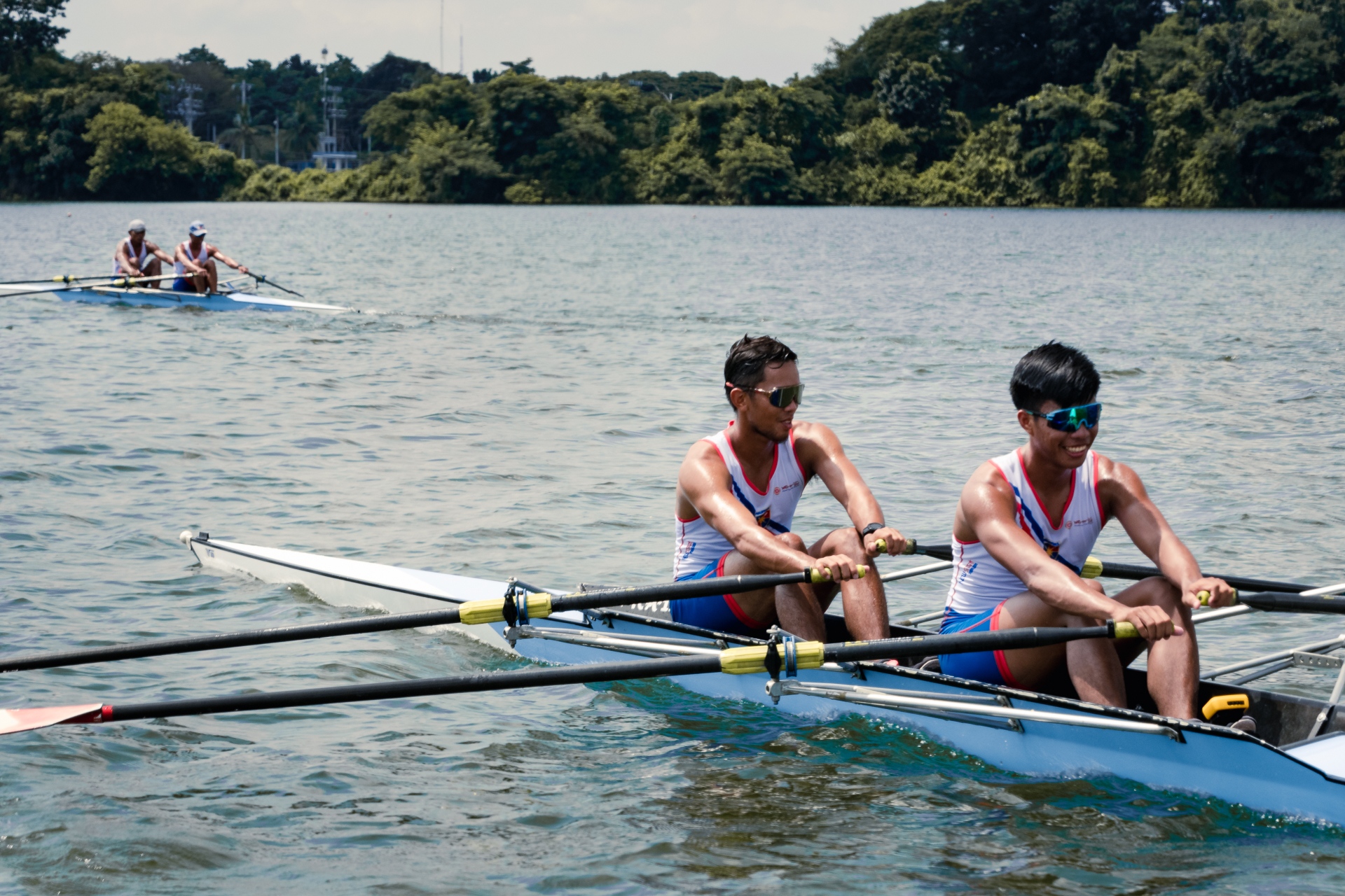 The Philippine National Rowing Team smile as they train at the La Mesa Watershed