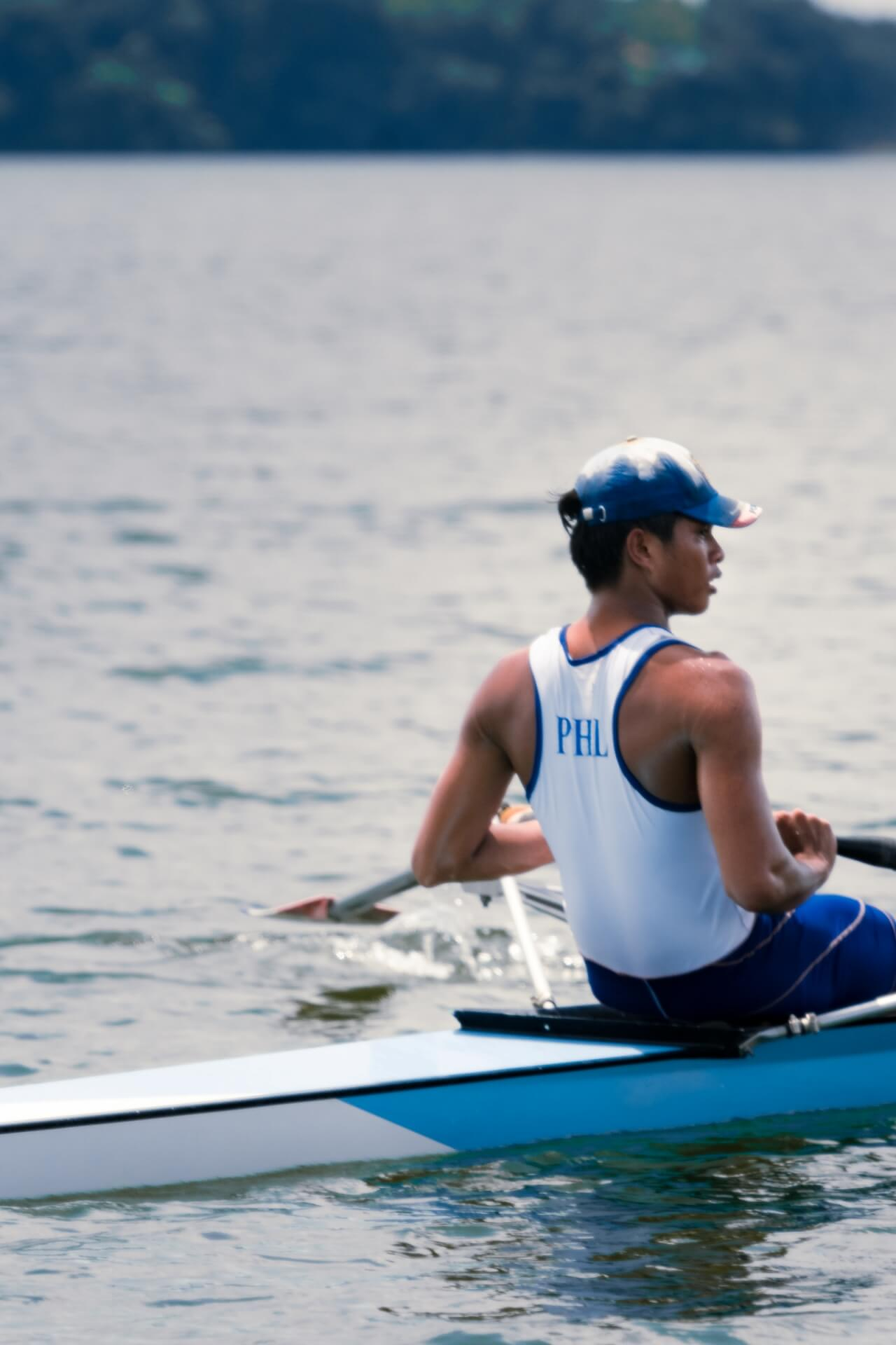 A male rower in a boat at the La Mesa Dam