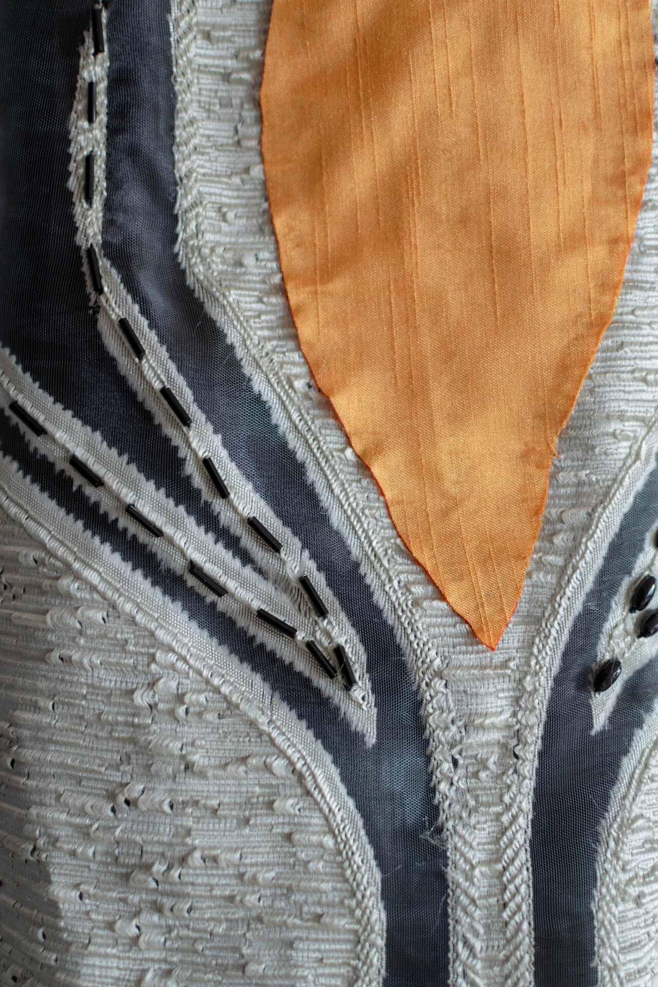 Textile details on a dress in Denuo's collection