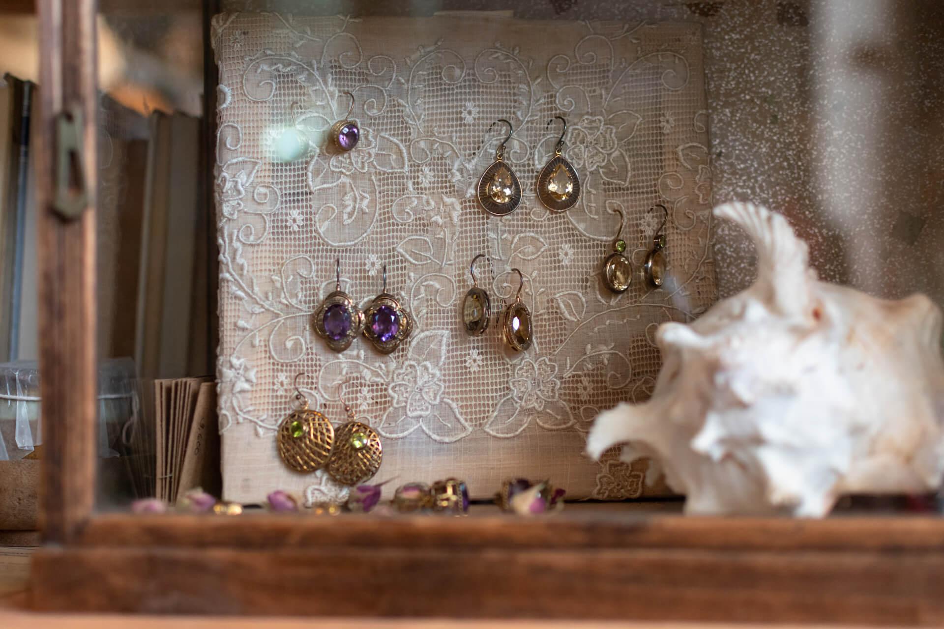 Vintage earrings on display at Glorious Dias