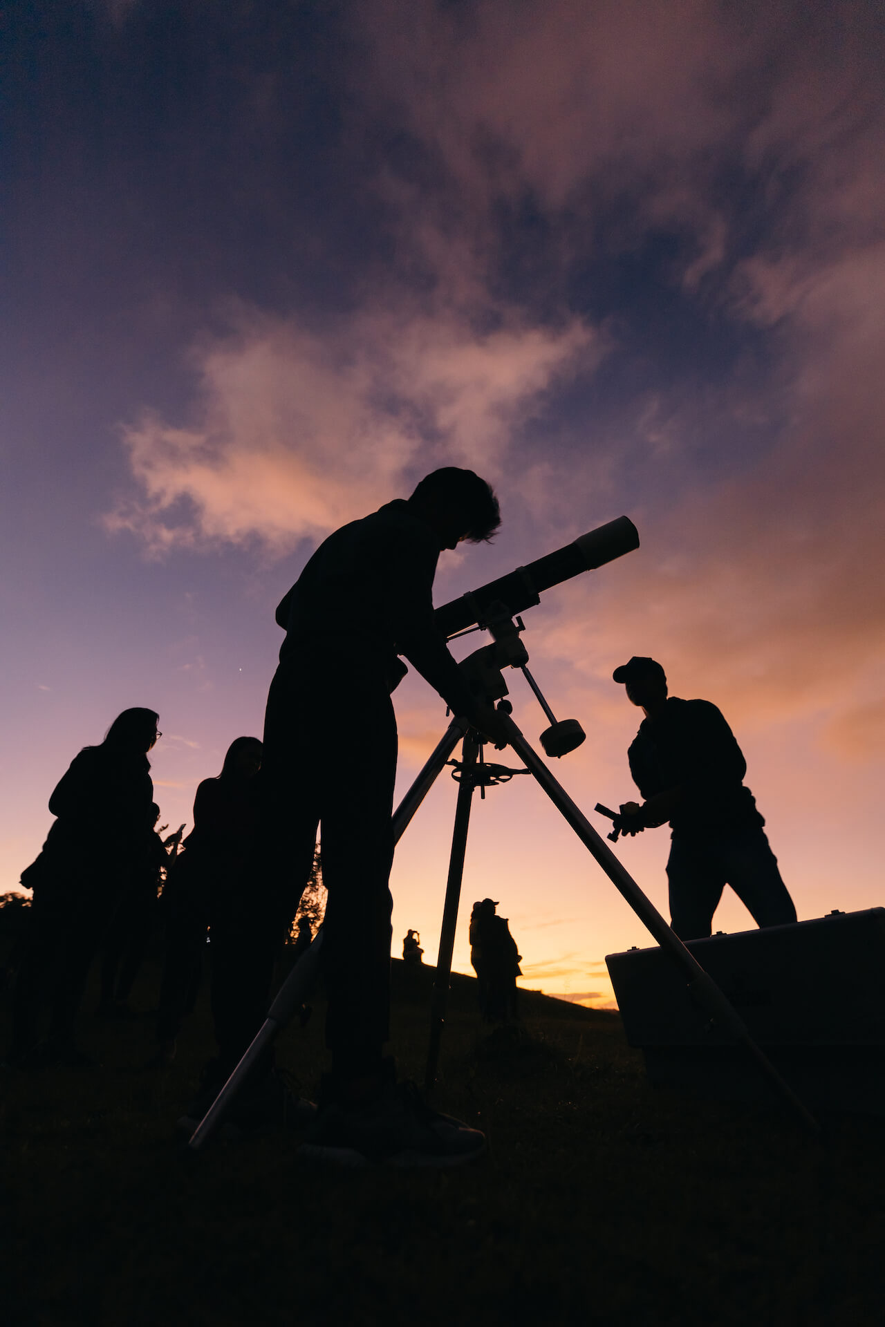 Members of the Philippine Astronomical Society set up a telescope as the sun sets