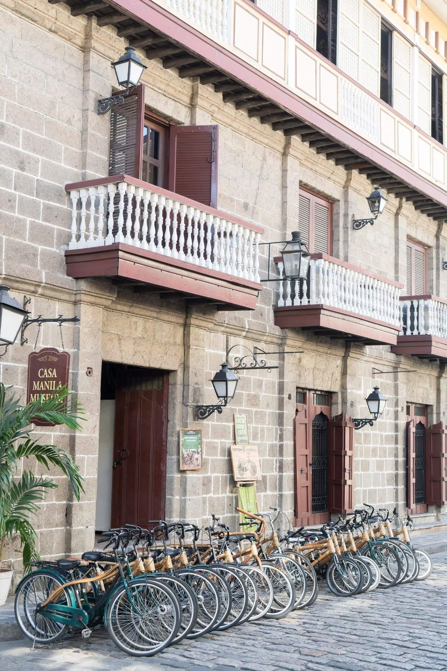 A row of bamboo bikes parked outside a baha na bato, Casa Manila Museum, in Intramuros