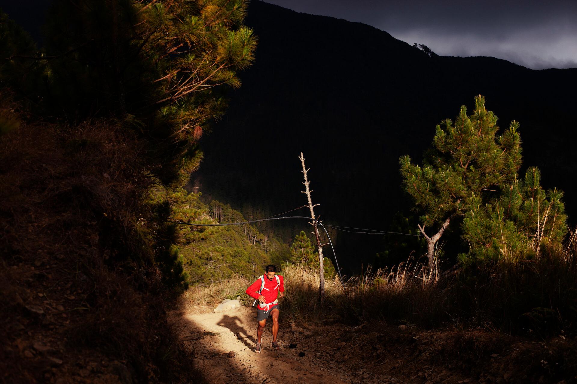 JP Alipio running through trails