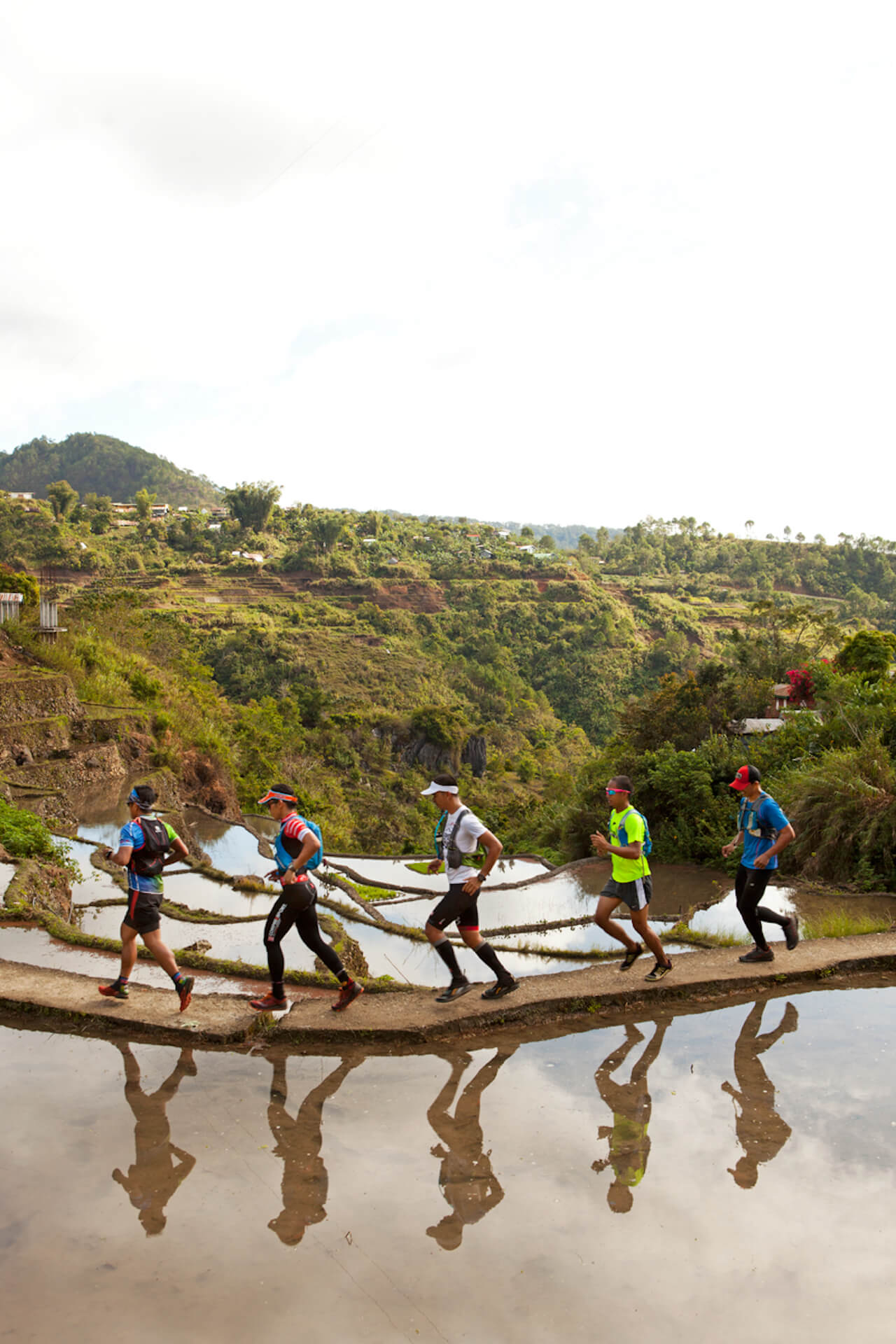 JP Alipio and the GRID Expedition team running through rice terraces in Bontoc