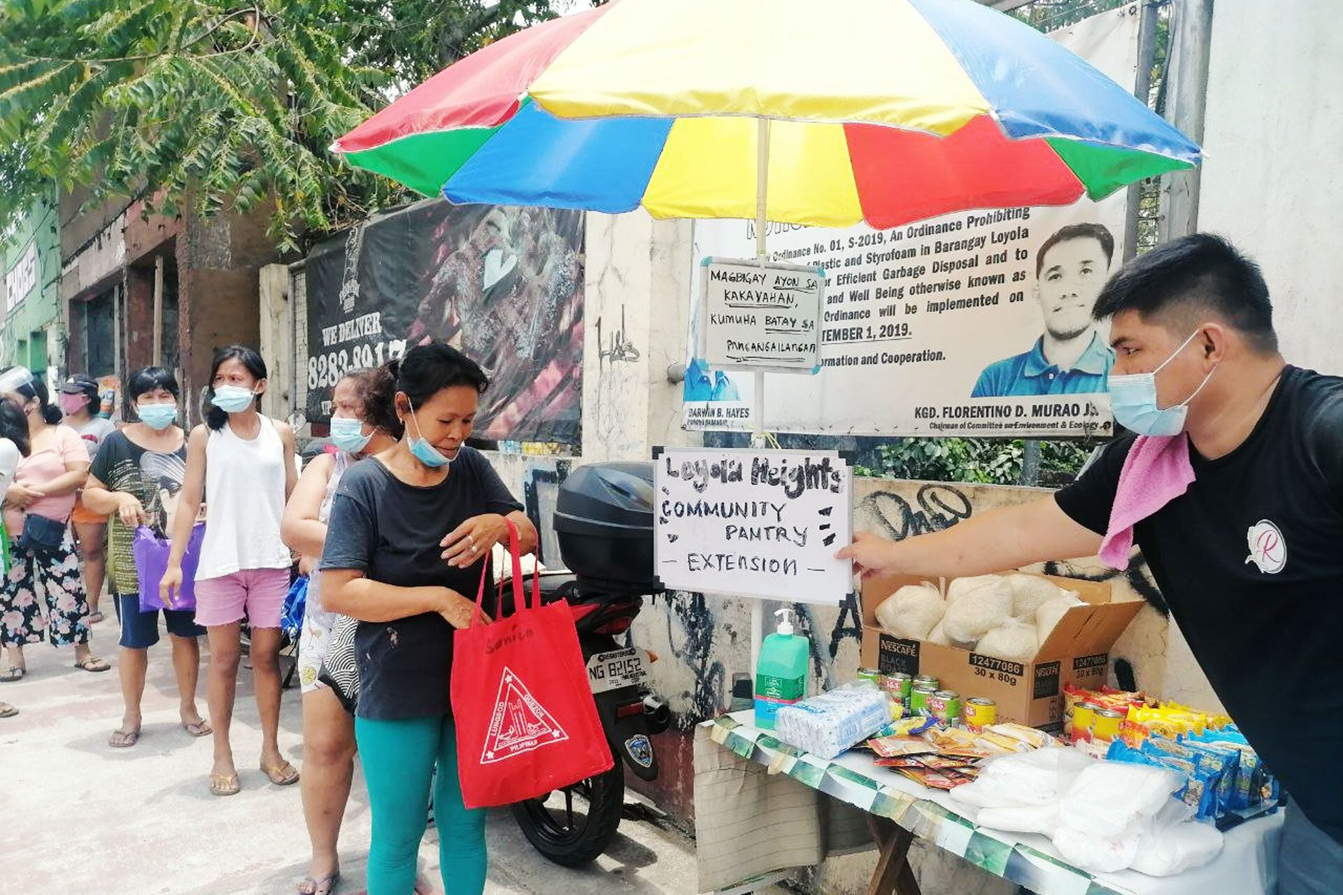 The Loyola Heights community pantry set up by volunteers