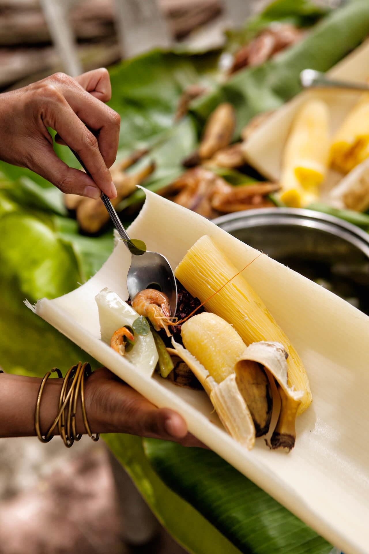 Shrimp and saba banana served on a bamboo plate