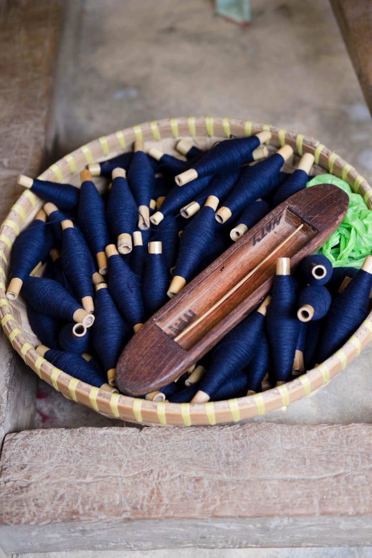 Spindles of dark blue threads