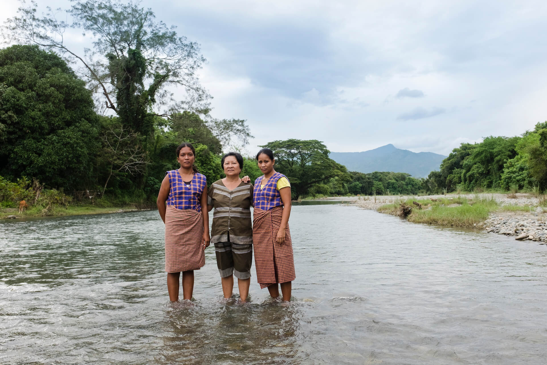 Rebecca Pantil, Naty Quiday, and Rosemalyn Figares wear the weaves of their community