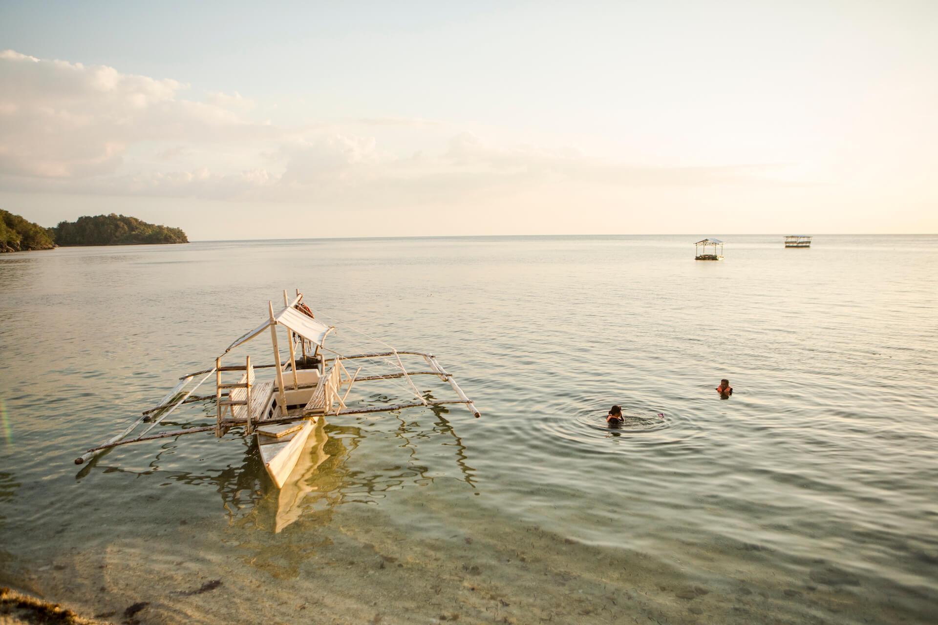 A boat on Danjugan's shore, photo by Geric Cruz
