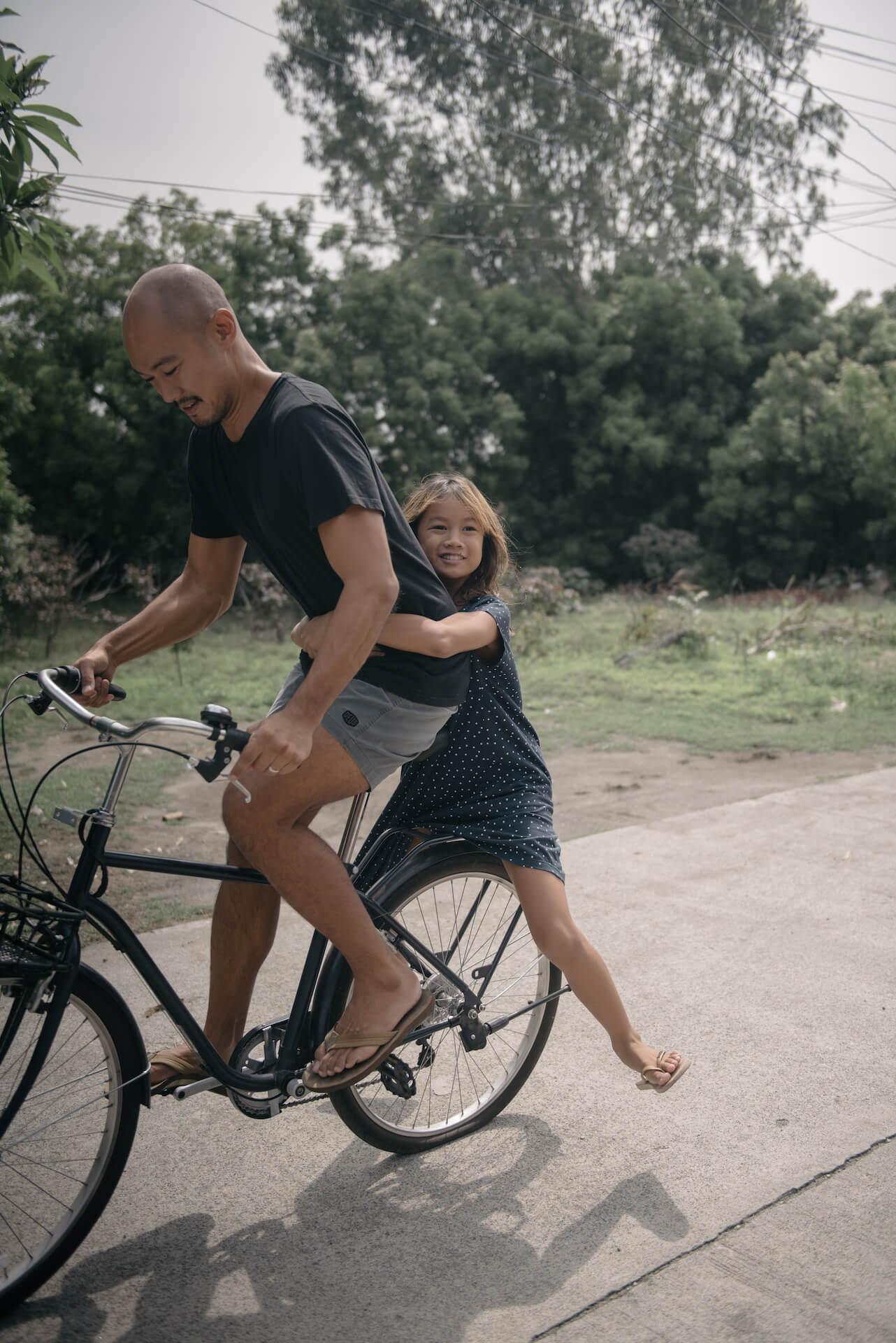 Kiddo and Cadence Cosio on a bike in La Union, photo by Tarish Zamora