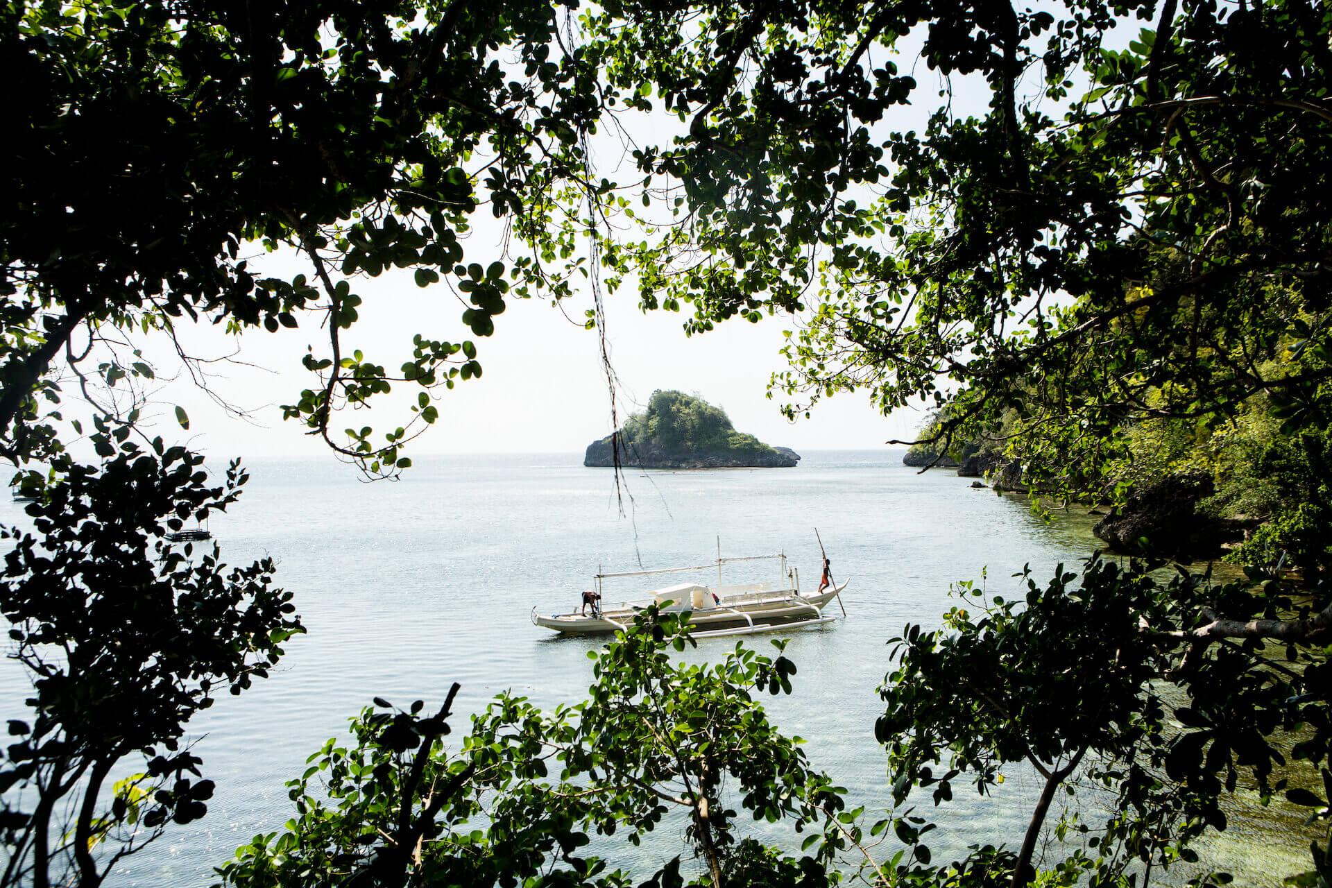 View of sea and boat from Danjugan, Negros. Photo by Geric Cruz