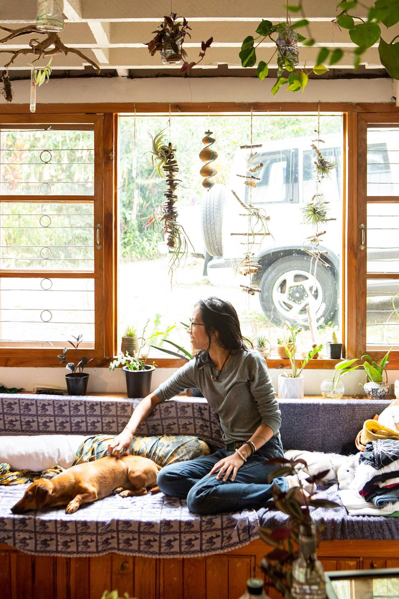 Solana Perez at home with her dog, photo by Miguel Nacianceno