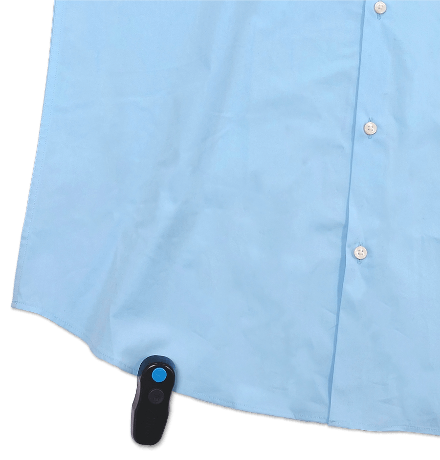 Light blue shirt with buttons with Zliide smart security tag for self-checkout on it