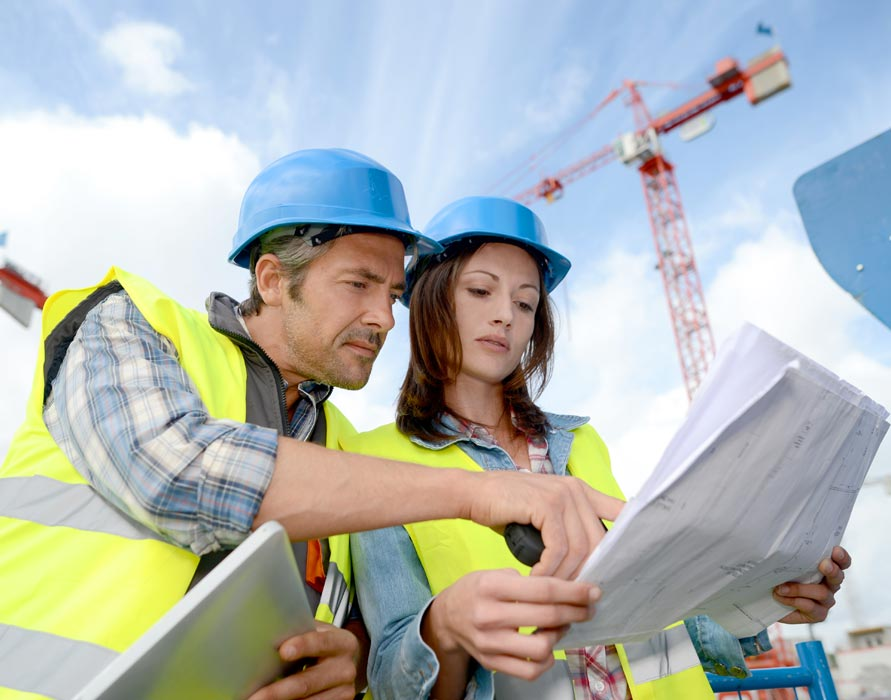 construction contractors reviewing bid details