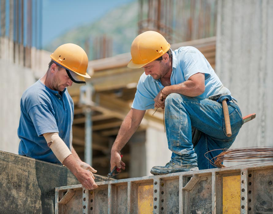 subcontractors working on commercial construction project