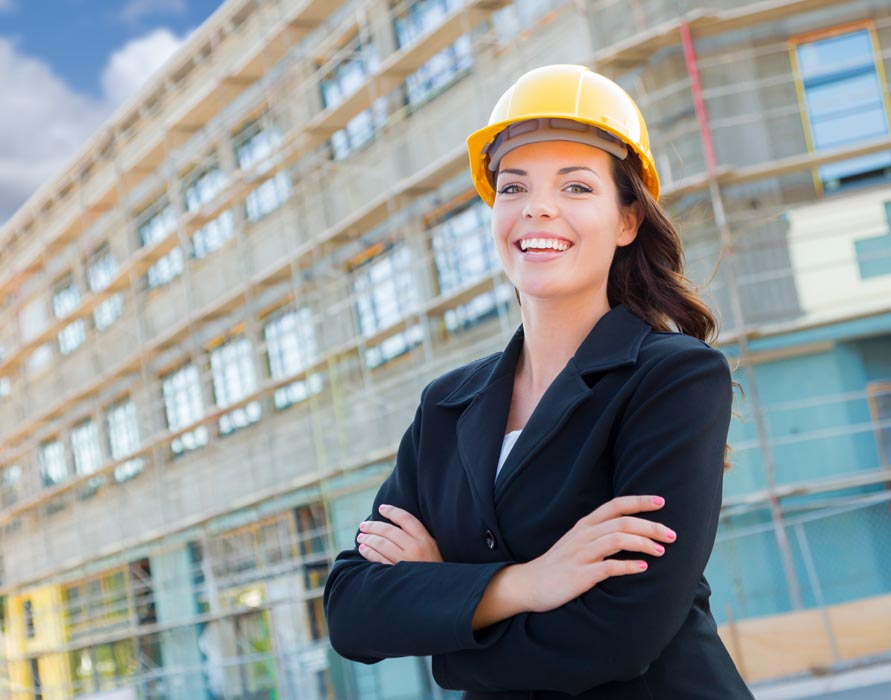 general contractor in front of building