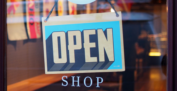 Image of a store with an Open sign
