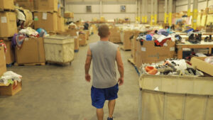resident walking through warehouse