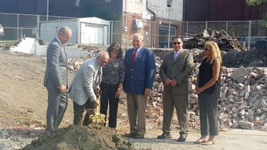 Members of the City Mission's board handle shovels during the groundbreaking of the Crabtree-Kovacicek Veterans House
