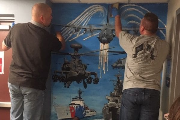 Two State Correctional Institute - Fayette install murals at the Crabtree-Kovacicek Veterans House