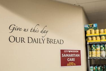 the sign in the Samaritan Care Center reads - 'give us this day our daily bread'
