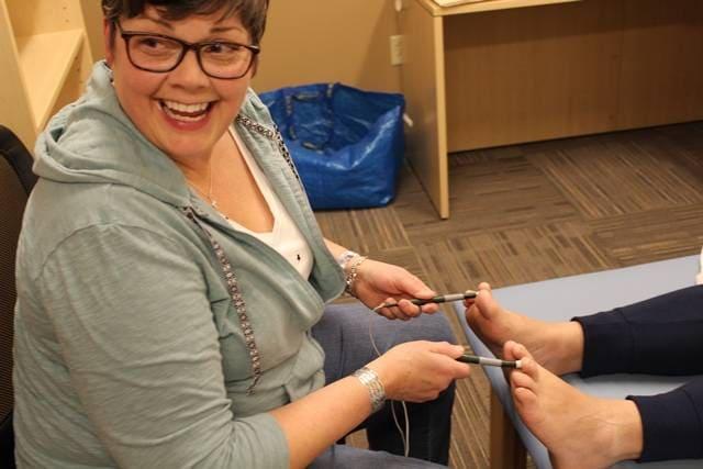 Nurse Cyndi administers alpha-stim therapy to resident Dave