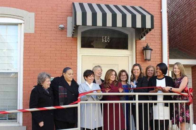 external view of entry way into the women & children's home where City Mission Staff, Residents and Commissioner Diana Irey-Vaughan prepare to cut the ribbon