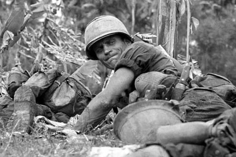 photo of soldier lying on the ground - during a combat engagement in Vietnam