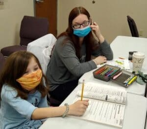 mother and daughter wears masks at preschool