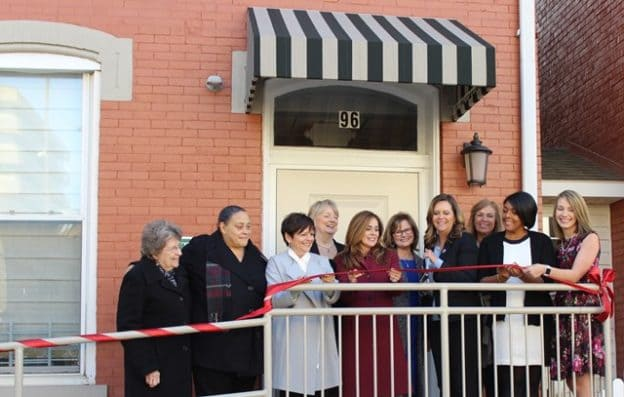 City Mission Staff Cut the Ribbon at the Women With Children Shelter