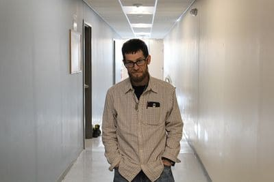 Dave posing in the hallway for a picture.