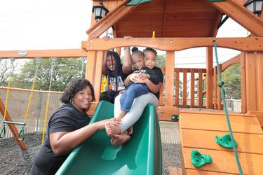 Kazmiere and her children at the City Mission playground