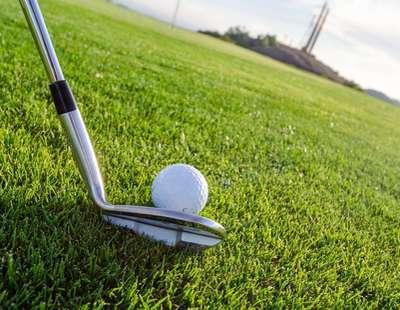 golf club aiming at a golf all