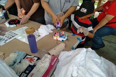 Residents making tie-dye shirts