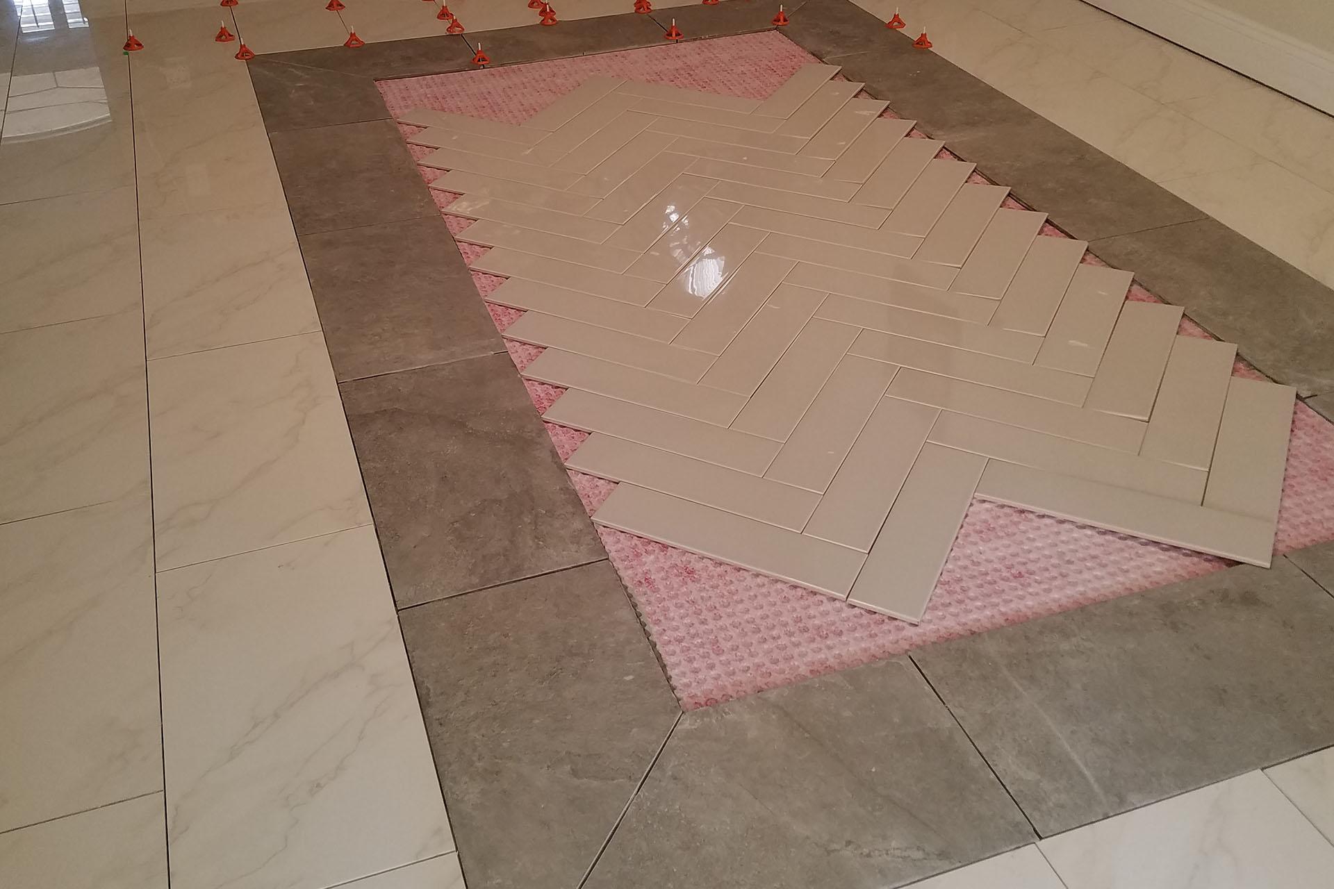 View Herringbone Tile Installation