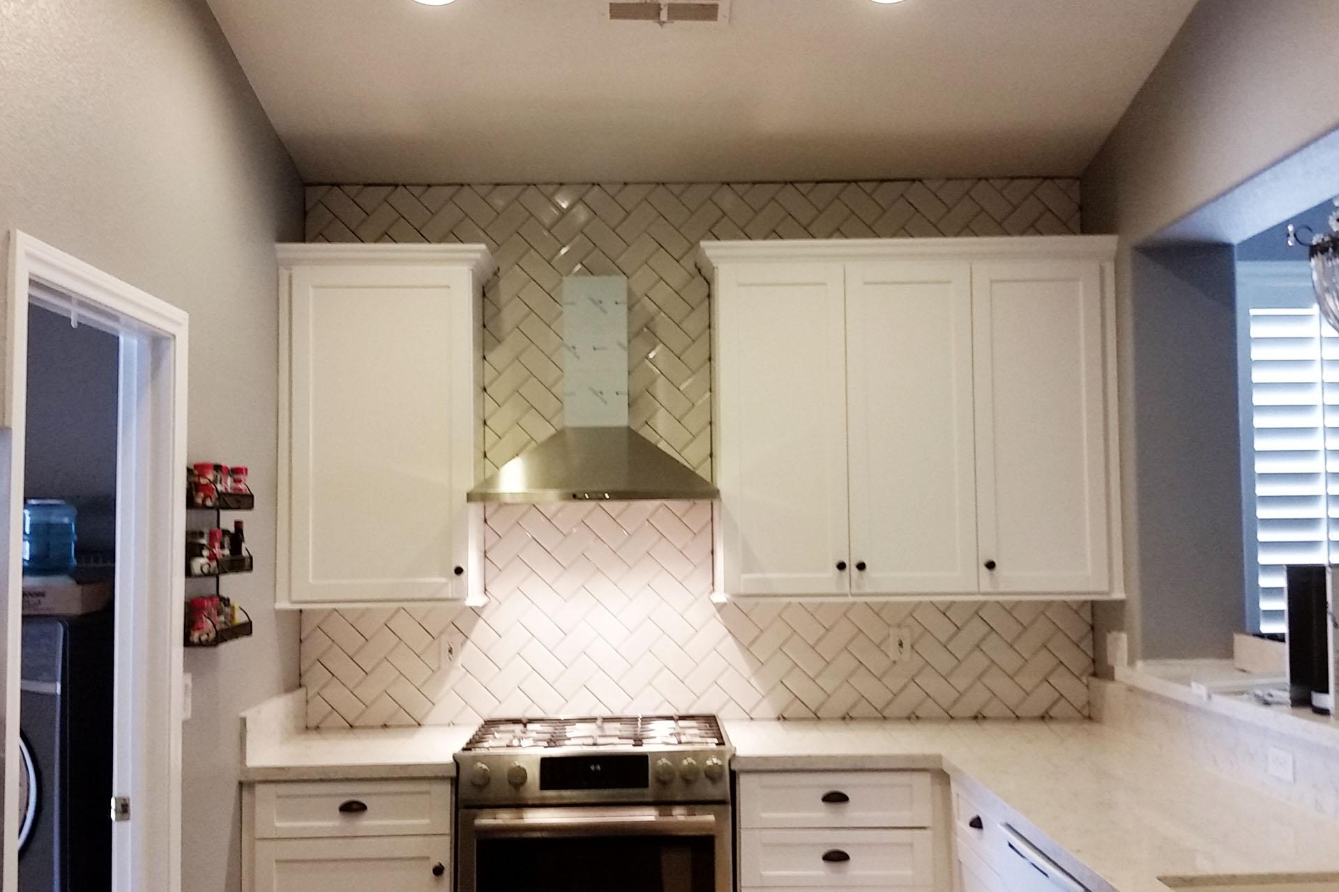 View Herringbone Tile Backsplash